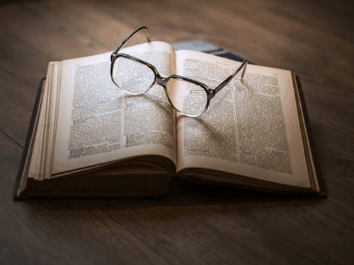 open book with glasses as a bookmark